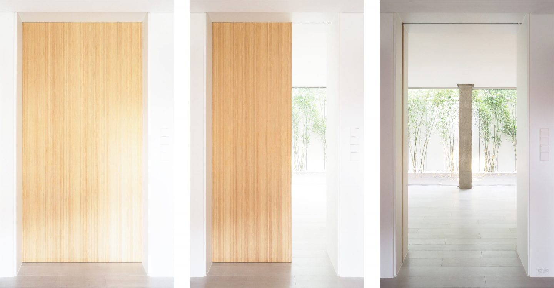 integración puerta corredera bambú macizo reforma Cabildo Valladolid Henka Arquitectos